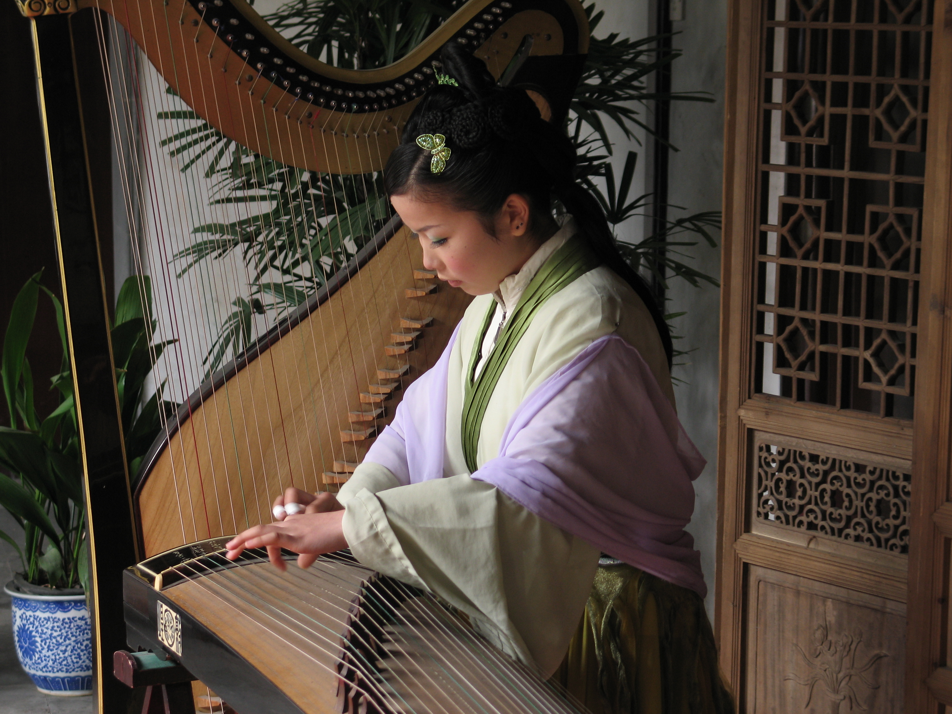 Chinese girl playing instrument by Richard Lund